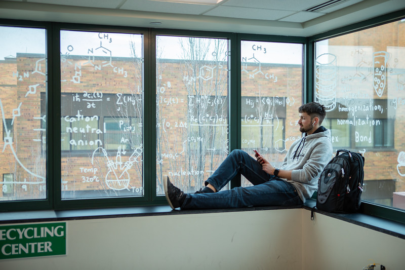 Window graphics of chemistry equations in the Natural Sciences Complex, a recent example of UB environmental branding.<br /> <br /> Photographer: Douglas Levere
