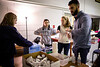 Several UB medical students staff a foot clinic event at Holy Cross Shelter in Buffalo, NY in December 2019. They are part of UB HEALS, which is a medicine outreach initiative of the Jacobs School of Medicine and Biomedical Sciences that aims to work with the chronically homeless. The group was able to offer new winter boots to several people during the clinic as well.<br /> <br /> Photographer: Meredith Forrest Kulwicki