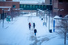 A snowy day in December 2019 on North Campus showing people walking on the spine.<br /> <br /> Photographer: Douglas Levere