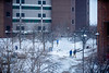 A snowy day in December 2019 on North Campus showing people walking near Hochstetter Hall.<br /> <br /> Photographer: Douglas Levere