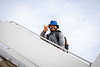 The UB Bulls Football team boards the plane heading to the Makers Wanted Bahamas Bowl on Dec. 16, 2019. <br /> <br /> Photographer: Meredith Forrest Kulwicki