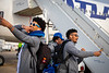 The UB Bulls Football team boards the plane heading to the Makers Wanted Bahamas Bowl on Dec. 16, 2019. Marlyn Johnson (left), and Caleb Tate (right, 25) stop for a photo by the plane.<br /> <br /> Photographer: Meredith Forrest Kulwicki
