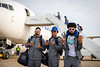 The UB Bulls Football team boards the plane heading to the Makers Wanted Bahamas Bowl on Dec. 16, 2019. Caleb Tate (left, 25) Trevor Wilson (center, 18) and Marlyn Johnson (right) stop for a photo by the plane.<br /> <br /> Photographer: Meredith Forrest Kulwicki