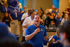 The UB band, cheerleaders, dance team as well as the football team, player's families and other members of the UB community gather in the lobby space of the Royal Towers at Atlantis Paradise Island Bahamas for a pep rally on Dec. 19, 2019. The team is preparing to play in the Makers Wanted Bahamas Bowl. Paul Peck emcees the pep rally.<br /> <br /> Photographer: Meredith Forrest Kulwicki