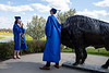 Students come to North Campus on May 16, 2020 to take photos in celebration of their graduations from various programs. The ceremonies were all held virtually because of the COVID-19 response. Carlye Albrecht, who studied media study, and Nathaniel George, who studied business, pose for photos with the Bronze Buffalo. <br /> <br /> Photographer: Meredith Forrest Kulwicki