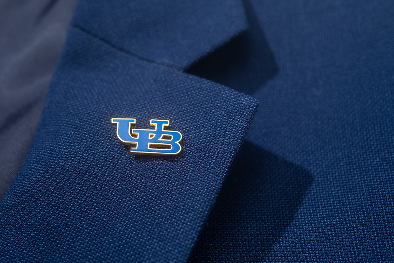 A UB pin on a dark blue suit lapel photographed in a studio setting in October 2020.<br /> <br /> Photographer: Douglas Levere