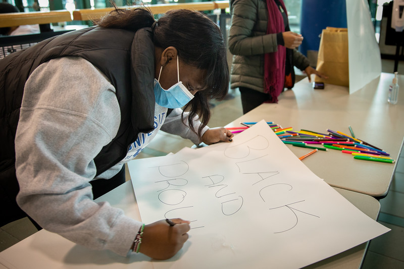 Organized by the Black Student Union, students gather to create posters at the Student Union and then march down the academic spine to Capen Hall in a rally for Black Solidarity Day in November 2020. The aim of the rally was to protest systemic racism and empower students to have a voice — and to vote — on Election Day.<br /> <br /> Photographer: Meredith Forrest Kulwicki<br /> <br /> This image has been approved by UB's Office of Environment, Health and Safety to align with current (fall 2020) health and safety regulations during the COVID-19 pandemic.