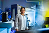 A portrait of Prathima Nalam, with material design and innovation in the School of Engineering and Applied Sciences, in a research lab in Bonner Hall in November 2020.<br /> <br /> Photographer: Douglas Levere<br /> <br /> This image has been approved by UB's Office of Environment, Health and Safety to align with current (fall 2020) health and safety regulations during the COVID-19 pandemic.