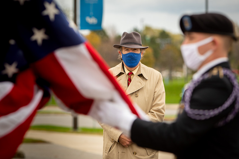ROTC members and Veteran Services work with UB Video Productions to create a Veterans Day video message for fall 2020 outside Alumni Arena in early November 2020. The COVID-19 pandemic changed how the groups would recognize the holiday. Pictured is director of UB's Veteran Services Dan Ryan. <br /> <br /> Photographer: Meredith Forrest Kulwicki<br /> <br /> This image has been approved by UB's Office of Environment, Health and Safety to align with current (fall 2020) health and safety regulations during the COVID-19 pandemic.