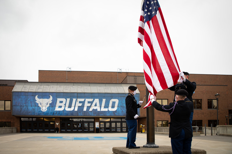 ROTC members and Veteran Services work with UB Video Productions to create a Veterans Day video message for fall 2020 outside Alumni Arena in early November 2020. The COVID-19 pandemic changed how the groups would recognize the holiday. <br /> <br /> Photographer: Meredith Forrest Kulwicki<br /> <br /> This image has been approved by UB's Office of Environment, Health and Safety to align with current (fall 2020) health and safety regulations during the COVID-19 pandemic.
