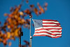 An American flag at the Flint Loop with a blue sky on North Campus in Novemebr 2020. <br /> <br /> Photographer: Meredith Forrest Kulwicki