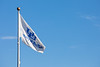 A UB flag new the Student Union with a blue sky on North Campus in Novemebr 2020. <br /> <br /> Photographer: Meredith Forrest Kulwicki