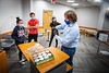 Dave Hoekstra, with biological sciences and founder of UB Bees, works with students to package honey from his on-campus beehives in Cooke Hall in November 2020. The honey was included in care packages for students quarantined in Goodyear Hall supplies by Student Engagement.<br /> <br /> Photographer: Douglas Levere<br /> <br /> This image has been approved by UB's Office of Environment, Health and Safety to align with current (fall 2020) health and safety regulations during the COVID-19 pandemic.