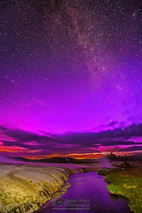 """Purple Magic,"" The Aurora Borealis and Milky Way over Iron Spring Creek and Cliff Geyser, Yellowstone National Park"