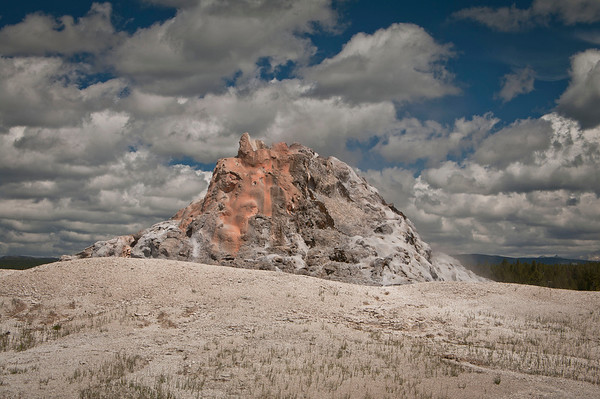 White Dome Geyser has been erupting for hundreds of years.  Its size would lead the viewer to believe that its eruptions would be huge but most are approximately 30 feet high.  Its vent is appearing to be sealing with deposits of sinter.