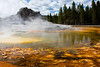 Castle geyser and its runoff, filled with vibrant bacteria.