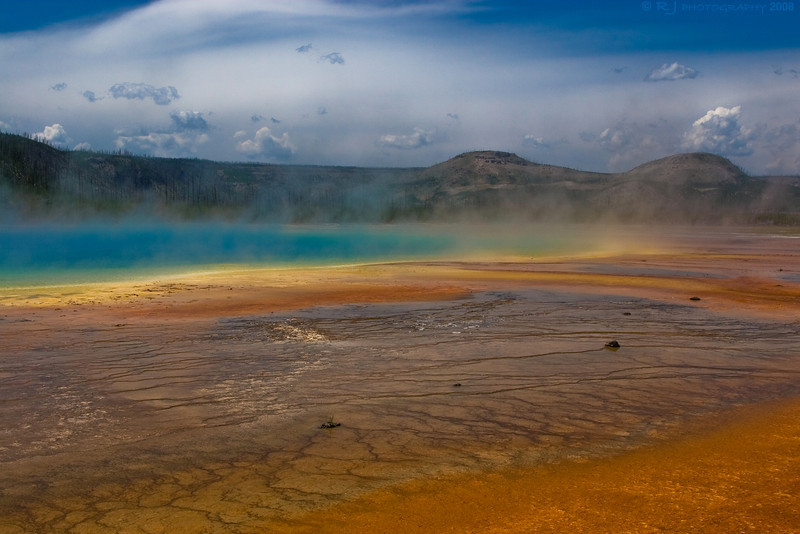 Grand Prismatic Spring. The bumps at the lower right are possibly from an older boardwalk.