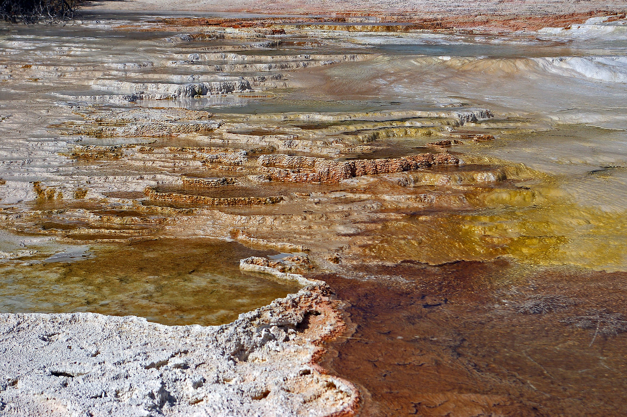 Mineral flows from hot volcanic pools