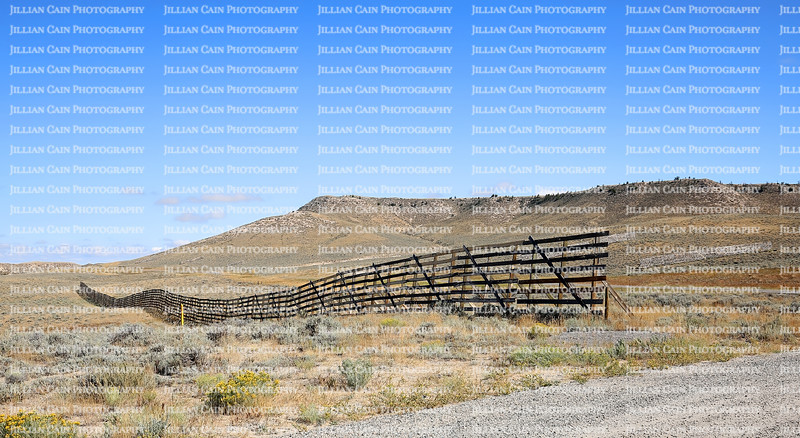 One of many snow fences in Wyoming.  Snow fences save lives by slowing down blowing snow and increasing visibility for drivers by keeping roads clear of snow, ice, and slush.