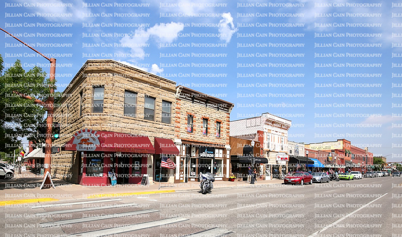"Downtown street in Cody, founded in 1896 by Colonel William F. ""Buffalo Bill"" Cody, designed with wide streets so his wagons could turn around."