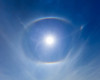 An ἅλως or halo, encompasses the sun as seen from atop the Beartooth Pass on a clear September day.  Typically these are seen on extremely cold days and are caused by ice crystal in the sky, but this day the optical phenomenon was caused by smoke from a nearby fire.   Captured with a Canon 5DII with 17-40/4.0L and Singh-Ray LB Polarizer in aperture priority mode with an exposure bias of + 1 1/3 at ISO200, f/13, and 1/200th of a second. The camera was handheld from a kneeling position.