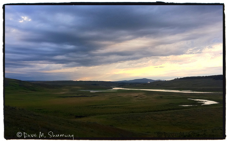 Sunrise as a summer thunderstorm moves through the Hayden Valley.<br /> iPhone Snap