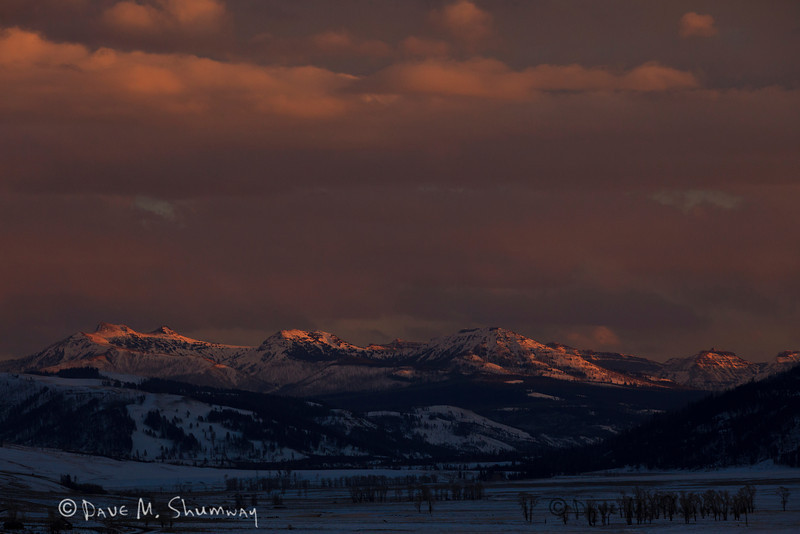 The absolute last bit of light breaks through the clouds to illuminate the mountains East of the Lamar River Valley in Yellowstone National Park. Captured with a Canon 5D II and 70-200/2.8L IS II in aperture priority mode with an exposure bias of - 1 at ISO400, f/7.1, and 1/400th of a second. The camera was handheld.