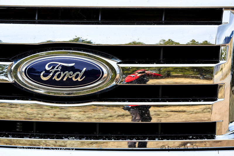 Photographer Dave M. Shumway reflecting in the grill of his new Ford F150.