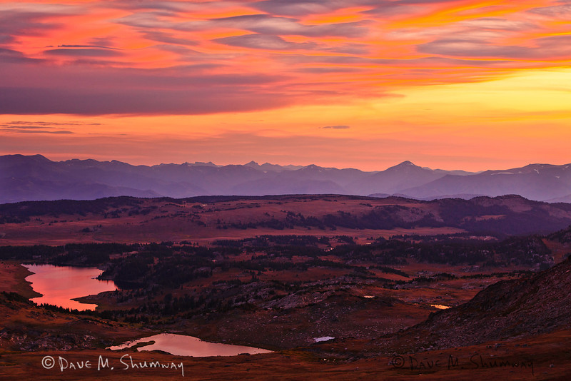 After the sun set behind the Beartooth Mountains the sky is set ablaze with color, and that color was also reflected off of the alpine lakes that dot the landscape.  Captured with a Canon 5DII and 70-200/2.8L IS II in aperture priority mode with an exposure bias of - 1/3 at ISO400, f/8.0, and 1/20th of a second. The camera was resting on a beanbag.