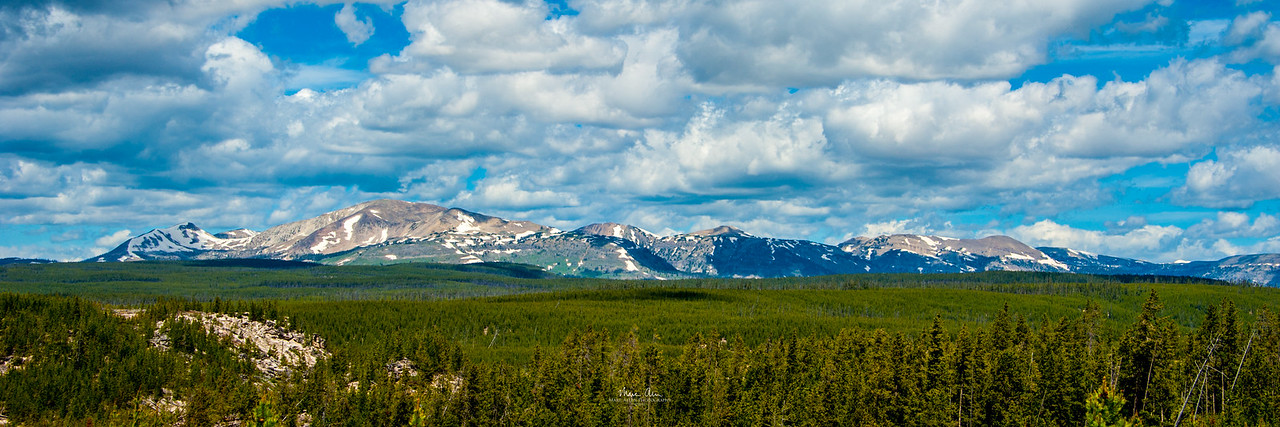 Some of the peaks along the wall of the Yellowstone Caldera, as seen from a viewpoint in the Norris Geyser Basin.  June  29, 2014.  I recommend purchasing this as a panorama print with an aspect ratio of 1:3.