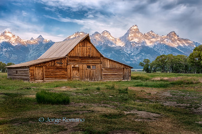 Moulton Mormon Barn with Grand Teton on a cloudy morning.