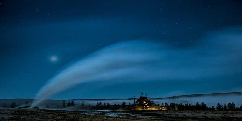 """ All Tucked Inn ""    ____ 3769Mh<br /> <br /> Visitors are tucked in as the steam of<br /> Old Faithful and late night fog form a<br /> blanket around the Old Faithful Inn.<br /> <br />  A beautiful panorama image when printed at 12""x24"" on Metal.<br /> Hang this gorgeous metal print on your wall for a real conversation piece<br /> of  your trip to Yellowstone ! <br /> <br /> This unique image is fused directly onto a specially treated, rigid piece of Aluminum.<br /> More archival and lighter than a framed paper print, it arrives ready to hang.<br /> The Float-Mounted MetalPrint™ needs no frame and<br /> will appear to float 3/4"" from your wall.<br /> <br /> Archival paper prints are also available<br /> ------- Contact us for more information -------<br /> moreinfo@RobertHowellPhotography.com"