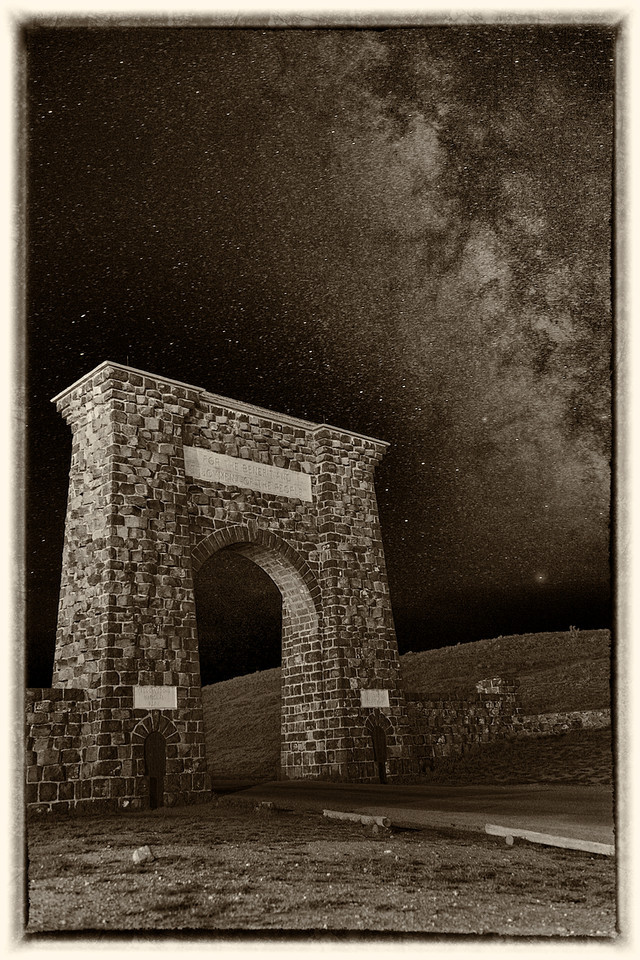 "'Open All Night'  II    __Roosevelt Arch    __0726M<br /> <br /> The Milky Way pauses above the 'North Gate' <br /> on this beautiful sepia tone metal print...<br /> <br /> The Roosevelt Arch hasn't changed much since its construction in 1903.  A recent appropriation of <br /> Centennial Challenge funds will go to the Gardiner Gateway Project to restore and enhance the park's only year-round entrance, the North Entrance --- the park's iconic Roosevelt Arch.<br /> <br /> <br /> This unique image is fused directly onto a specially treated, rigid piece of Aluminum.<br /> More archival and lighter than a framed paper print, it arrives ready to hang.<br /> The Float-Mounted MetalPrint™ needs no frame and<br /> will appear to float 3/4"" from your wall.<br /> <br /> Archival paper prints are also available<br /> ------- Contact us for more information -------<br /> moreinfo@RobertHowellPhotography.com"