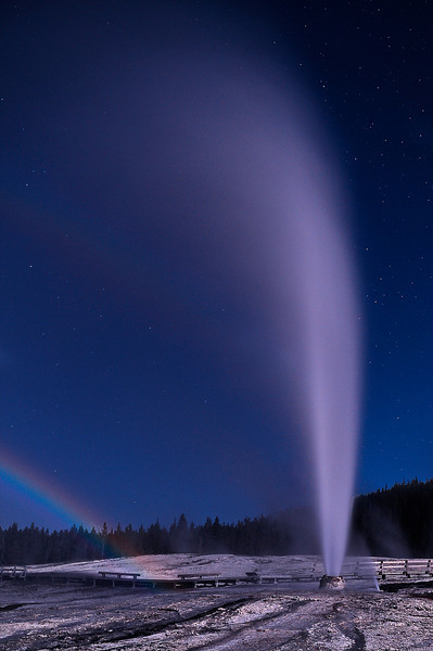 """ Moonbow ""     ______  9617Lv <br /> <br /> A bright full moon outshines the stars, lights up the thermal landscape and creates a 'Lunar Rainbow' through the steam of the erupting Beehive Geyser.<br /> <br /> Beehive Geyser's eruptions are dramatic and hard to predict because the time between eruptions is so erratic.<br /> <br /> Eruptions typically last about five minutes, with water and steam shooting up to 200 feet into the air. <br /> <br /> This unique image is fused directly onto a specially treated, rigid piece of Aluminum.<br /> More archival and lighter than a framed paper print, it arrives ready to hang.<br /> The Float-Mounted MetalPrint™ needs no frame and<br /> will appear to float 3/4"" from your wall.<br /> <br /> Archival paper prints are also available<br /> ------- Contact us for more information -------<br /> moreinfo@RobertHowellPhotography.com"