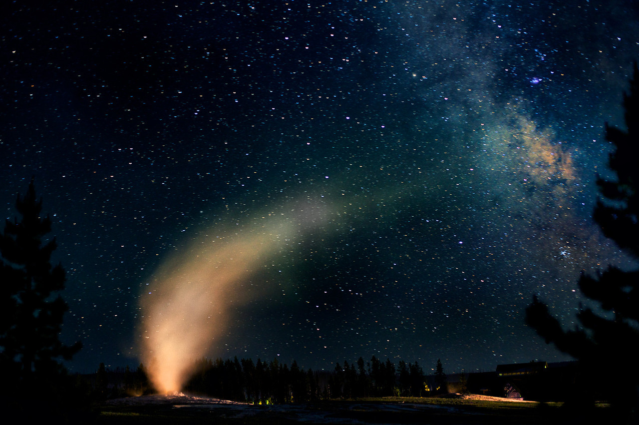 """ Dancing with the Stars ""    ____ 6232L<br /> <br /> Old Faithful dances with the Milky Way every night as visitors sleep in the Old Faithful Inn<br /> <br /> Hang this gorgeous metal print on your wall for a beautiful keepsake<br /> of your visit to Yellowstone !<br /> <br /> This unique image is fused directly onto a specially treated, rigid piece of Aluminum.<br /> More archival and lighter than a framed paper print, it arrives ready to hang.<br /> The Float-Mounted MetalPrint™ needs no frame and<br /> will appear to float 3/4"" from your wall.<br /> <br /> Archival paper prints are also available<br /> ------- Contact us for more information -------<br /> moreinfo@RobertHowellPhotography.com"