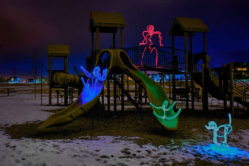 "LuminBeings™ on the Playground     ____ 7703L<br /> <br /> ""Here, We Are All The Same""  <br /> ~ CAMP MAK-A-DREAM<br /> ......................................................................................................................................................... 100% profit of this print will go to CAMP MAK-A-DREAM a medically supervised, cost-free Montana experience in an intimate community setting for children, teens, young adults, women and families affected by cancer,  Programs are offered throughout the year for those around the country who have a sibling or a parent with cancer.<br /> ..........................................................................................................................................................  For more on Camp, donations and volunteering, call (406) 549-5987<br /> or visit  <a href=""http://www.CampDream.org"">http://www.CampDream.org</a><br /> a 501(c)(3) nonprofit organization.<br /> ......................................................................................................................................................... For those of you who fish....check out this year's Walleye Benefit tournament at Canyon Ferry reservoir in Townsend on Saturday, August 1. Proceeds benefit Camp Mak-A-Dream. Thanks to Walleyes Forever of MT and MT Pikemasters clubs for their support and sponsorship of this event. Get more information and registration forms here:  <a href=""http://cmadbenefit.bigskyoutdoors.net/"">http://cmadbenefit.bigskyoutdoors.net/</a><br /> ......................................................................................................................................................... <br /> .<br /> .<br /> <br /> <br /> This unique image is fused directly onto a specially treated, rigid piece of Aluminum.<br /> More archival and lighter than a framed paper print, it arrives ready to hang.<br /> The Float-Mounted MetalPrint™ needs no frame and<br /> will appear to float 3/4"" from your wall.<br /> <br /> Archival paper prints are also available<br /> ------- Contact us for more information -------<br /> moreinfo@RobertHowellPhotography.com"