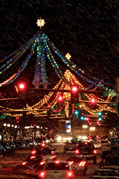 """Christmas Spiders"" of Bozeman""   __ 9837M<br /> ...on the way to YELLOWSTONE AT NIGHT<br /> <br /> <br /> The famous garland & lights decorations in Bozeman, MT affectionately known as the ""Christmas Spiders"" hang over four intersections of Main Street, at Willson, Tracy, Black and Bozeman Avenues.<br /> ......................................................................................................................................................... 100% profit of this print will go to the Bozeman Warming Center. The Warming Center is a seasonal shelter offering an alternative to the cold Montana winters, offering shelter to anyone in need. Families with children, youth, single adults and couples. You can imagine how freaking cold it is outside. Every purchase provides warmth. ~~~ Thank-you. ......................................................................................................................................................... Created in partnership with the Greater Gallatin Homeless Action Coalition the Warming Center is a part of the HRDC's Housing First Program -- part of the community since 2010. ......................................................................................................................................................... <a href=""http://www.thehrdc.org/programs/warming-center/"">http://www.thehrdc.org/programs/warming-center/</a>"