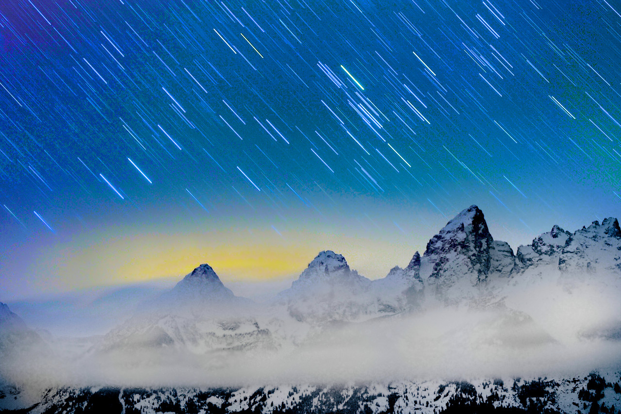 """ The Tetons Peek ""    ____ 8268Lh<br /> <br /> The Grand Tetons peek through the clouds<br /> after the sun sets and the stars appear<br /> <br /> <br /> This unique image is fused directly onto a specially treated, rigid piece of Aluminum.<br /> More archival and lighter than a framed paper print, it arrives ready to hang.<br /> The Float-Mounted MetalPrint™ needs no frame and<br /> will appear to float 3/4"" from your wall.<br /> <br /> Archival paper prints are also available<br /> ------- Contact us for more information -------<br /> moreinfo@RobertHowellPhotography.com"
