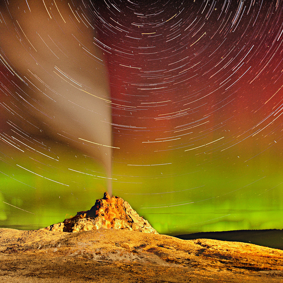 """ The Greatest Show ""   ____ 4494628Ls<br /> <br /> The Stars Circle throughout the night as a Yellowstone Geyser erupts<br /> and a Rare Aurora Borealis appears as a backdrop<br /> <br /> This unique image is fused directly onto a specially treated, rigid piece of Aluminum.<br /> More archival and lighter than a framed paper print, it arrives ready to hang.<br /> The Float-Mounted MetalPrint™ needs no frame and<br /> will appear to float 3/4"" from your wall.<br /> <br /> Archival paper prints are also available<br /> ------- Contact us for more information -------<br /> moreinfo@RobertHowellPhotography.com"