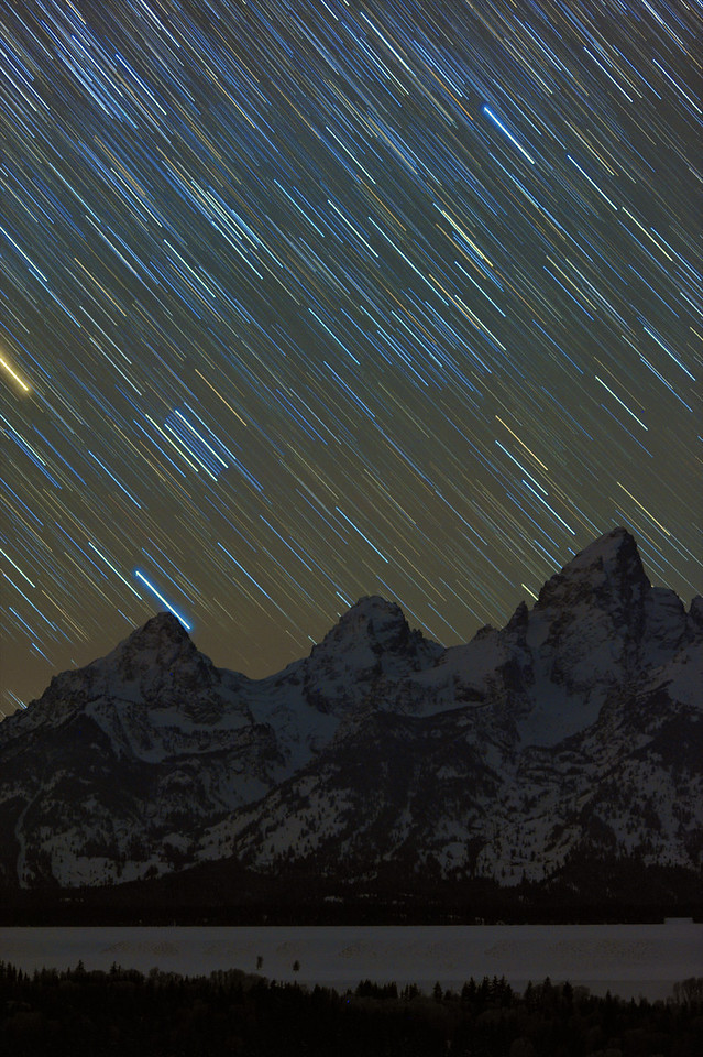 """Star Colors over The Grand Tetons     ____ 8284Lv<br /> <br /> <br /> This unique image is fused directly onto a specially treated, rigid piece of Aluminum.<br /> More archival and lighter than a framed paper print, it arrives ready to hang.<br /> The Float-Mounted MetalPrint™ needs no frame and<br /> will appear to float 3/4"""" from your wall.<br /> <br /> Archival paper prints are also available<br /> ------- Contact us for more information -------<br /> moreinfo@RobertHowellPhotography.com"""