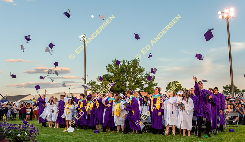 Graduating Seniors toss their caps into the air at the close of the graduation ceremony.