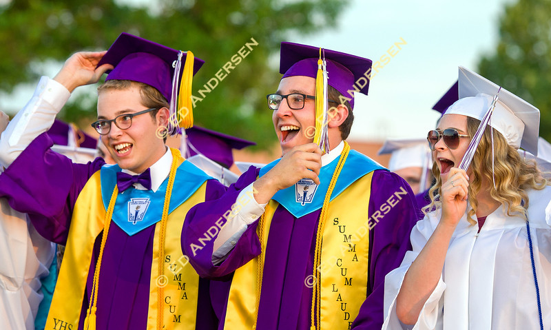 Graduating Seniors move their tassels at the close of the graduation ceremony.