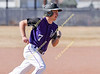 Yerington Baseball Tournament in Yerington, NV. Varsity baseball action; Yerington vs. Bishop, March 9, 2018.<br /> Yerington's Justin Olmstead rounds 3rd base trying to score during Friday's game against Bishop Union. Yerington and Bishop Union played to a 5-5 tie.