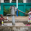 Monrovia, Liberia October 13, 2017 - Sreet scene with kids at water pump.