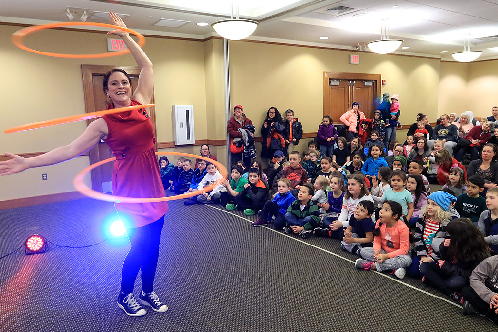. The yo-yo duo of Rebecca and John Higby performed at the Leominster Public Library on Wednesday afternoon for packed room full of kids. during the show Rebecca performed with three hula hoops. SENTINEL & ENTERPRISE/JOHN LOVE