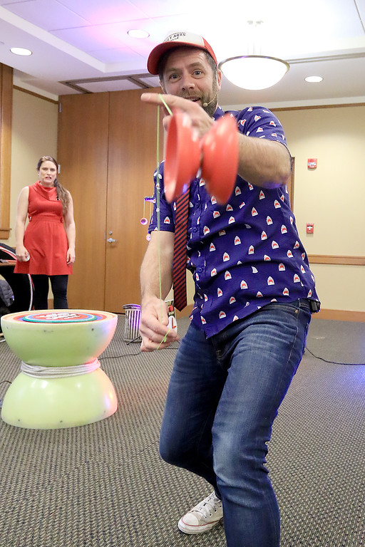 . The yo-yo duo of Rebecca and John Higby performed at the Leominster Public Library on Wednesday afternoon for packed room full of kids. John showed off for the camera during one of his tricks. SENTINEL & ENTERPRISE/JOHN LOVE