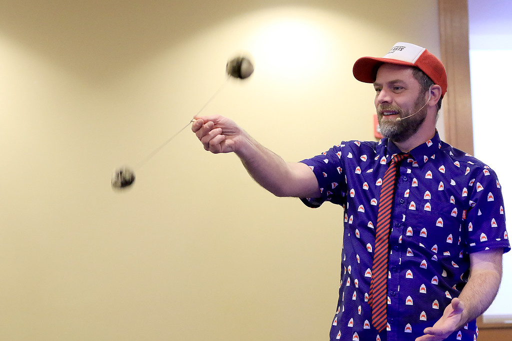 . The yo-yo duo of Rebecca and John Higby performed at the Leominster Public Library on Wednesday afternoon for packed room full of kids. John shows he can work two yo-yo\'s in the same hand. SENTINEL & ENTERPRISE/JOHN LOVE