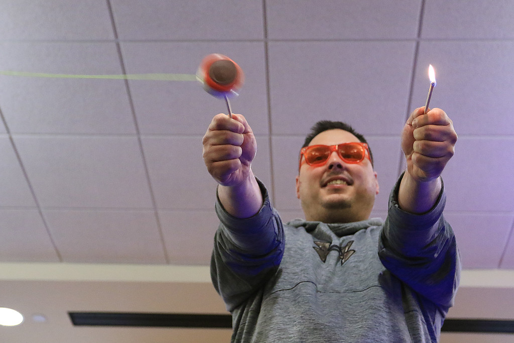 . The yo-yo duo of Rebecca and John Higby performed at the Leominster Public Library on Wednesday afternoon for packed room full of kids. Helping out in the show was parent Sal Perla who held two matches and John showed he could light them with his yo-yo. SENTINEL & ENTERPRISE/JOHN LOVE