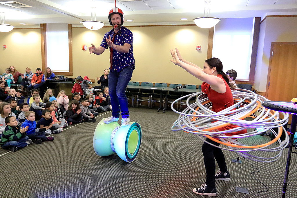 . The yo-yo duo of Rebecca and John Higby performed at the Leominster Public Library on Wednesday afternoon for packed room full of kids. To end the show John stood on a large yo-yo, usied two yo-yo\'s and had a plate spinning on his head while Rebecca showed she could hula hoop with 20 hula hoops. SENTINEL & ENTERPRISE/JOHN LOVE