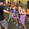 "Brett Outchcunis, better know as ""Ooch"", brought his Ooch World to the Leominster Public Library on Thursday afternoon. He entertained them with some yo-yo tricks and then some group dancing for everyone, even the parents. SENTINEL & ENTERPRISE/JOHN LOVE"